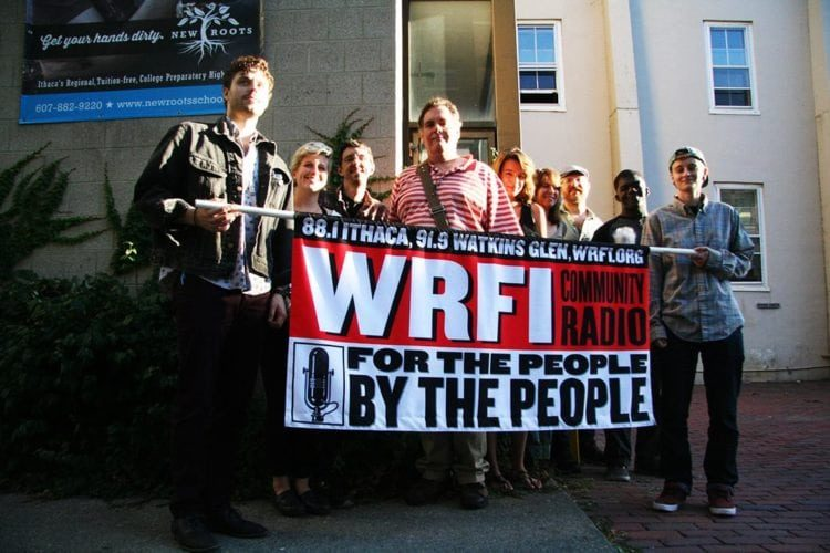 WRFI staff and volunteers outside WRFI headquarters in the back of the Historic Clinton House in downtown Ithaca. Photo credit: Liz