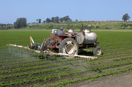 Farmer in Watsonville, California spraying crops with pesticides EPA